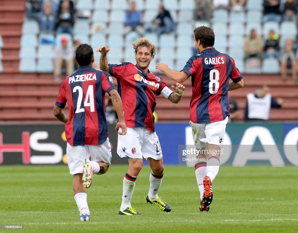 Alessandro Diamanti (C) of Bologna FC celebrates with their teams mate after scoring his opening goal during the Serie A match between Udinese Calcio and Bologna FC at Stadio Friuli on September 15, 2013 in Udine, Italy.