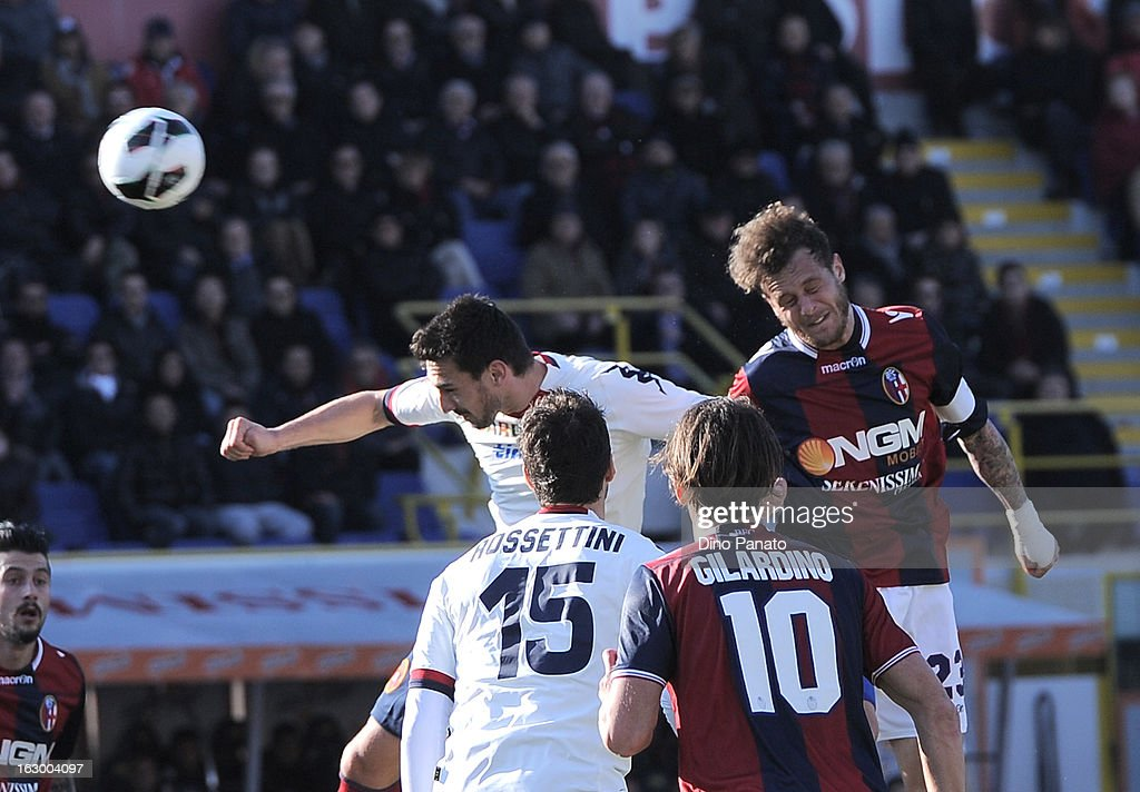 Alessandro Diamanti (R) of Bologna FC competes with Davide Astori of Cagliari Calcio during the Serie A match between Bologna FC and Cagliari Calcio at Stadio Renato Dall'Ara on March 3, 2013 in Bologna, Italy.
