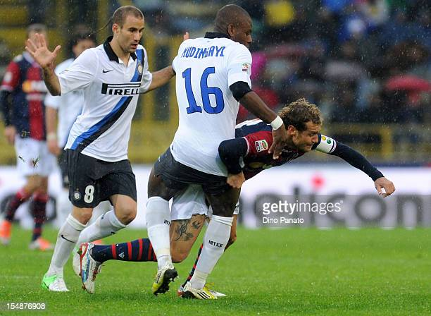 Alessandro Diamanti of Bologna FC competes with Gaby Mudingayii of FC Internazionale Milano during the Serie A match between Bologna FC and FC...