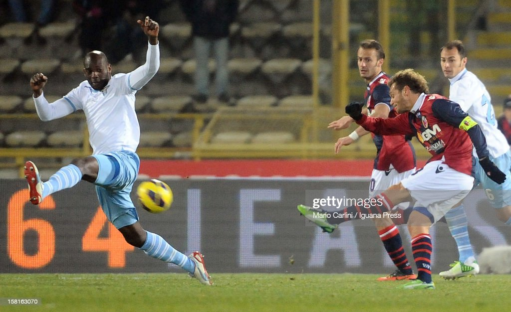 Alessandro Diamanti # 23 of Bologna FC ( R ) kicks on goal during the Serie A match between Bologna FC and S.S. Lazio at Stadio Renato Dall'Ara on December 10, 2012 in Bologna, Italy.