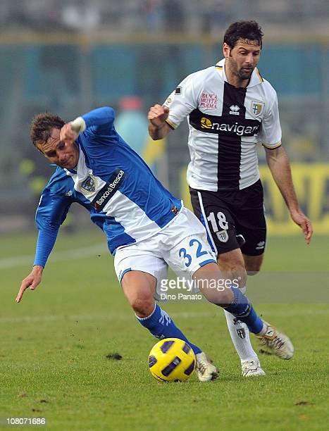 Alessandro Diamanti of Brescia Calcio competes with Massimo Gobbi of Parma FC during the Serie A match between Brescia Calcio and Parma FC at Mario...