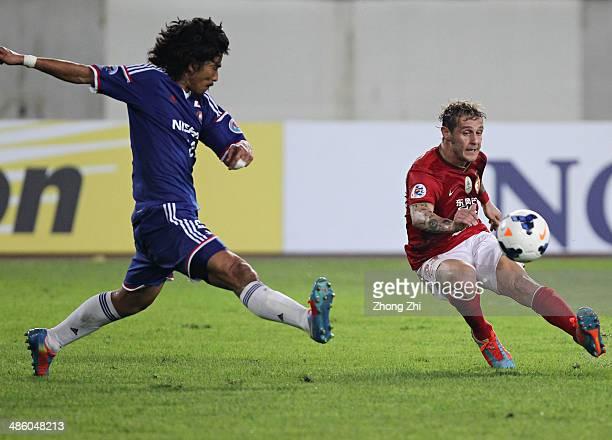 Alessandro Diamanti of Guangzhou Evergrande in action with Nakazawa Yuji of Yokohama F. Marinos during the AFC Asian Champions League match between...