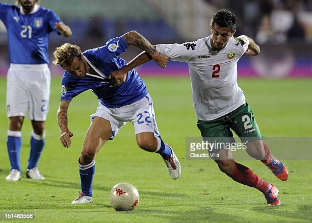 Alessandro Diamanti of Italy and Stanislav Manolev of Bulgaria compete for the ball during the FIFA 2014 World Cup Qualifier group B match between...