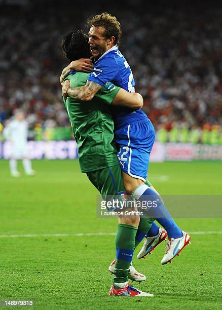 Alessandro Diamanti of Italy celebrates scoring the winning penalty with Gianluigi Buffon during the UEFA EURO 2012 quarter final match between...