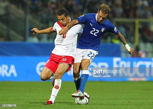 Alessandro Diamanti of Italy competes for the ball with Roderik Briffa of Malta during the FIFA 2014 World Cup qualifier match between Italy and...