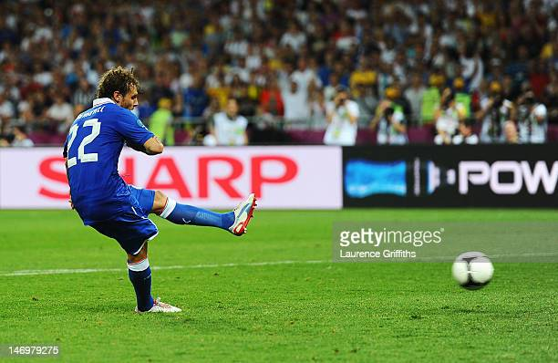 Alessandro Diamanti of Italy scores the winning penalty during the UEFA EURO 2012 quarter final match between England and Italy at The Olympic...
