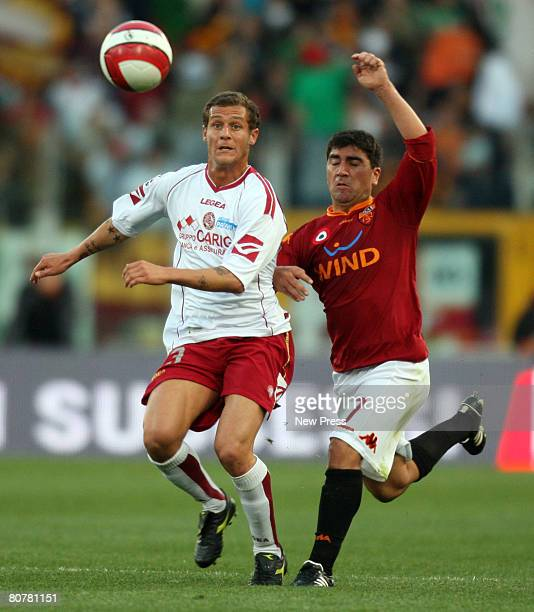 Alessandro Diamanti of Livorno and 2 of Roma in action during the Serie A match between Roma and Livorno at the Stadio Olimpico on April 19 2008 in...