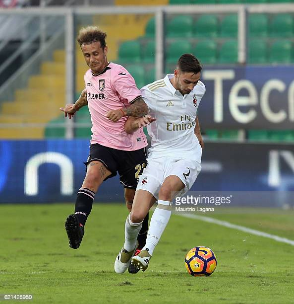 Alessandro Diamanti of Palermo competes for the ball with Mattia De Sciglio of Milan during the Serie A match between US Citta di Palermo and AC...