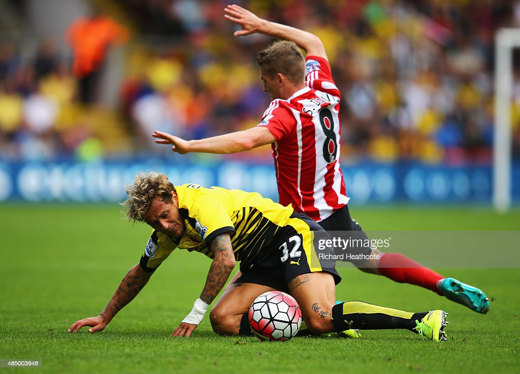 Alessandro Diamanti of Watford is challenged by Steven Davis of Southampton during the Barclays Premier League match between Watford and Southampton at Vicarage Road on August 23, 2015 in Watford, England.