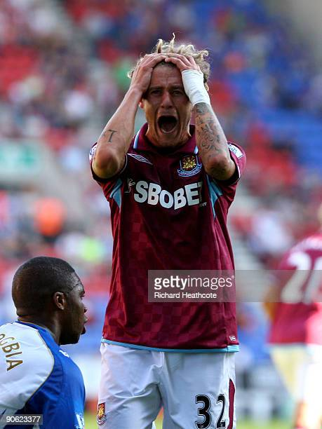 Alessandro Diamanti of West Ham reacts to hitting the post with a shot during the Barclays Premier League match between Wigan Athletic and West Ham...