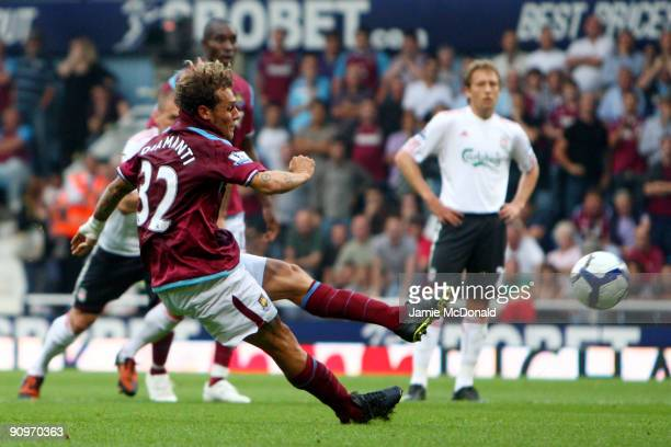 Alessandro Diamanti of West Ham scores a penalty during the Barclays Premier League match between West Ham United and Liverpool at Upton Park on...