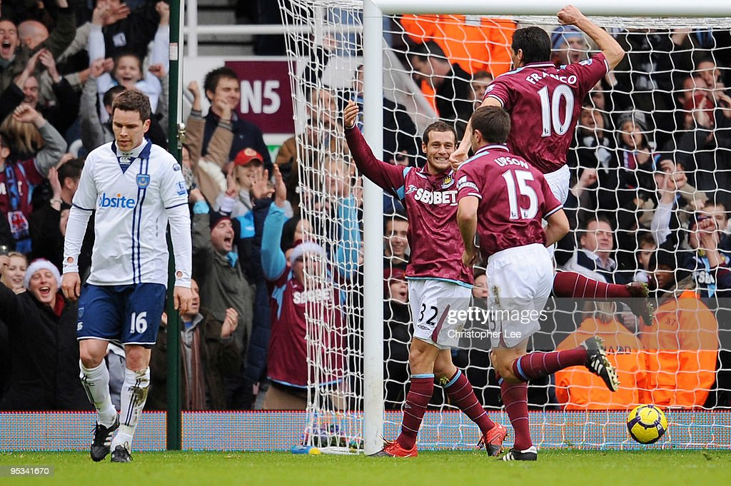 Alessandro Diamanti of West Ham United celebrates with his team mates after he scored a penalty during the Barclays Premier League match between West Ham United and Portsmouth at Boleyn Ground on December 26, 2009 in London, England.