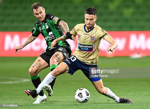 Alessandro Diamanti of Western United and Apostolos Stamatelopoulos of the Jets compete for the ball during the A-League match between Western United...