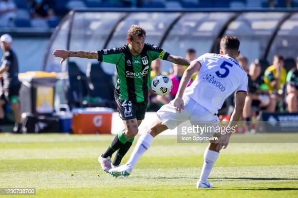 Alessandro Diamanti of Western United FC controls the ball in front of Jonathan Aspropotamitis of Perth Glory during match week 5 of the 2021...