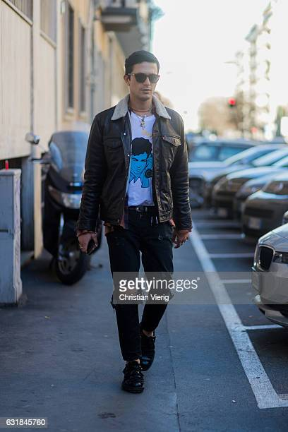 Alessandro Enriquez is wearing a leather jacket black ripped denim jeans sunglasses at Etro during Milan Men's Fashion Week Fall/Winter 2017/18 on...