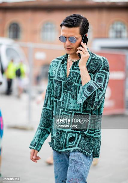 Alessandro Enriquez wearing button shirt with graphic print is seen during the 94th Pitti Immagine Uomo on June 13 2018 in Florence Italy