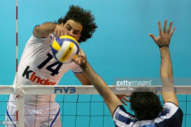 Alessandro Fei of Italy spikes against Argentina during the FIVB Men's World Olympic Qualification Tournament match between Argentina and Italy at...