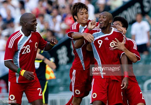 Alessandro Ferreira Leonardo of Hong Kong League XI is congratulated after scoring against Birmingham City during the Xtep Cup which is part of...