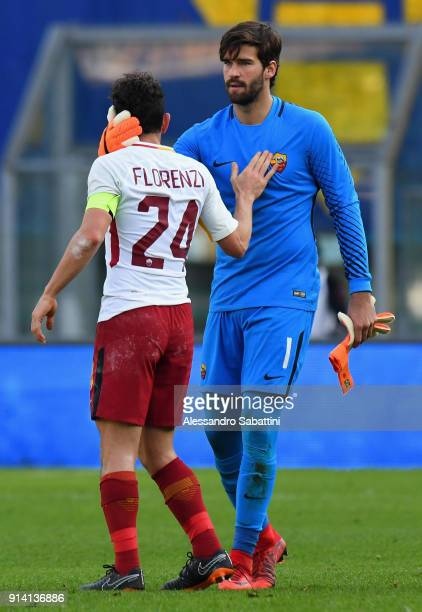 Alessandro Florenzi and Alisson Becker of AS Roma celebrate the victory after the serie A match between Hellas Verona FC and AS Roma at Stadio...