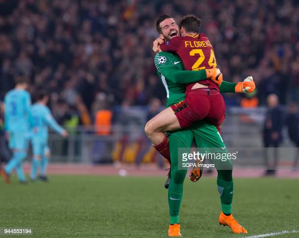 Alessandro Florenzi and Allison of Rome celebrate the victory during UEFA Champions League quarter final match between AS Roma and FC Barcelona at...
