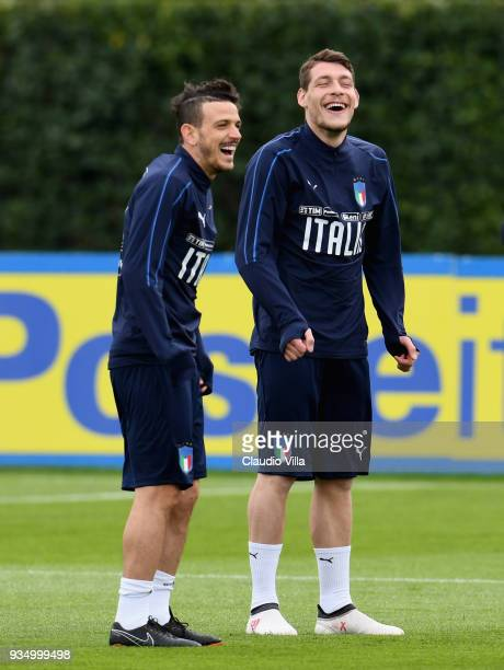 Alessandro Florenzi and Andrea Belotti of Italy smile during a training session at Centro Tecnico Federale di Coverciano on March 20 2018 in Florence...