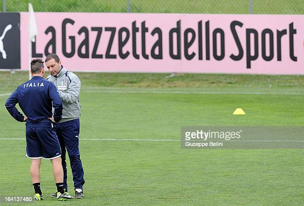 Alessandro Florenzi and Denis Mangia head coach of Italy U21 during a training session on March 20 2013 in Camposanpiero near Padova Italy
