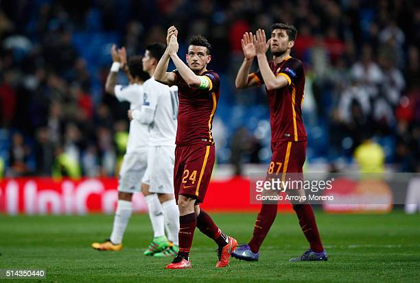 Alessandro Florenzi and Ervin Zukanovic of Roma applaud the fans after the UEFA Champions League Round of 16 Second Leg match between Real Madrid and...