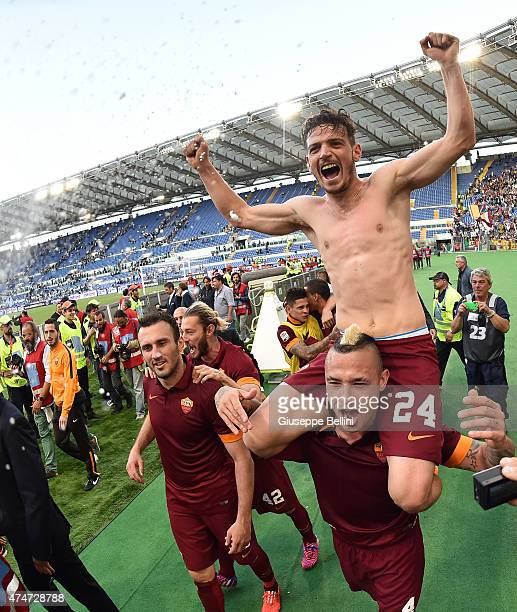 Alessandro Florenzi and Radja Nainggolan of AS Roma celebrate the victory after the Serie A match between SS Lazio and AS Roma at Stadio Olimpico on...