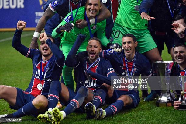Alessandro Florenzi, Neymar Jr and Angel Di Maria of Paris Saint-Germain celebrate with the trophy after the Champions Trophy match between Paris...