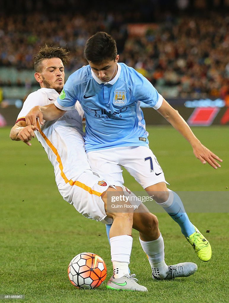 Alessandro Florenzi of AS Roma and Manu Garcia of Manchester City compete for the ball during the International Champions Cup friendly match between Manchester City and AS Roma at the Melbourne Cricket Ground on July 21, 2015 in Melbourne, Australia.