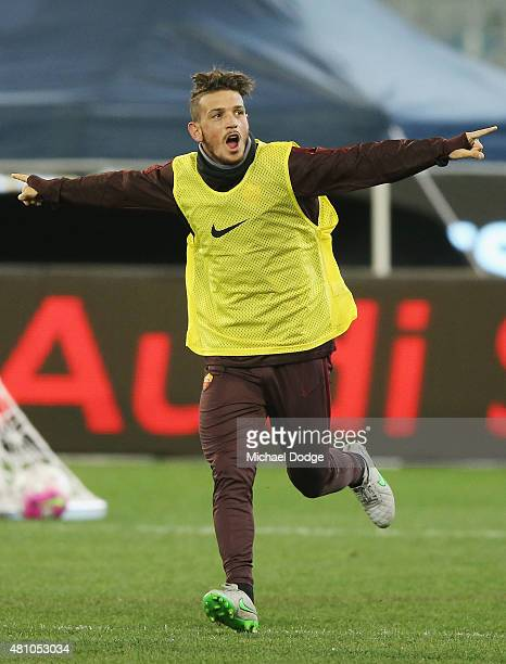 Alessandro Florenzi of AS Roma celebrates a goal during an AS Roma training session at Melbourne Cricket Ground on July 17 2015 in Melbourne Australia