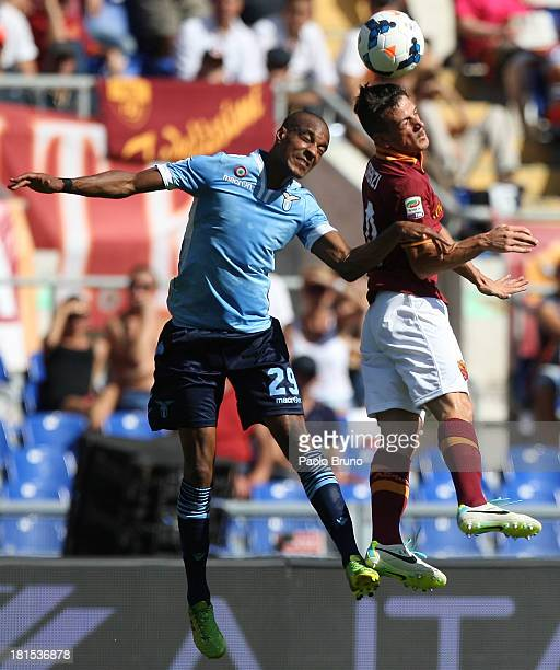 Alessandro Florenzi of AS Roma competes for the ball with Abdoulay Konko of SS Lazio during the Serie A match between AS Roma and SS Lazio at Stadio...