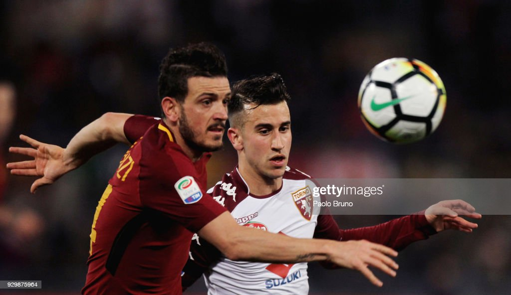Alessandro Florenzi of AS Roma competes for the ball with Alejandro Berenguer of Torino FC during the Serie A match between AS Roma and Torino FC at Stadio Olimpico on March 9, 2018 in Rome, Italy.