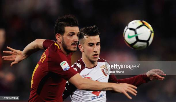 Alessandro Florenzi of AS Roma competes for the ball with Alejandro Berenguer of Torino FC during the Serie A match between AS Roma and Torino FC at...