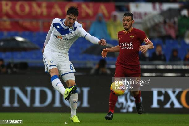 Alessandro Florenzi of AS Roma competes for the ball with Emanuele Endoj of Brescia Calcio during the Serie A match between AS Roma and Brescia...