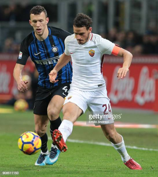 Alessandro Florenzi of AS Roma competes for the ball with Ivan Perisic of FC Internazionale Milano during the Serie A match between FC Internazionale...