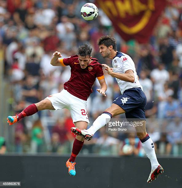 Alessandro Florenzi of AS Roma competes for the ball with Luca Rossettini of Cagliari Calcio during the Serie A match between AS Roma and Cagliari...