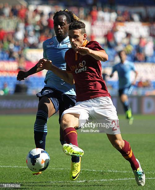 Alessandro Florenzi of AS Roma competes for the ball with Pedro Luis Cavanda of SS Lazio during the Serie A match between AS Roma and SS Lazio at...