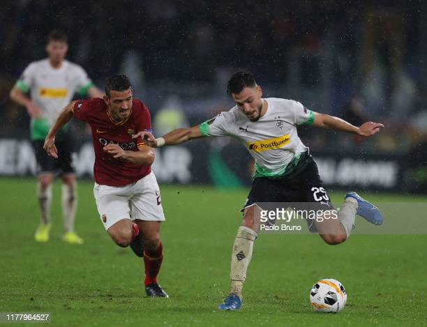 Alessandro Florenzi of AS Roma competes for the ball with Ramy Bensebaini of Borussia Moenchengladbach during the UEFA Europa League group J match...