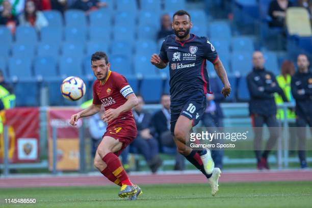 Alessandro Florenzi of AS Roma is challenged by Joao Pedro of Cagliari during the Serie A match between AS Roma and Cagliari at Stadio Olimpico on...