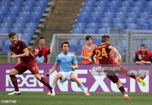 Alessandro Florenzi of AS Roma scores the team's third goal during the Serie A match between SS Lazio and AS Roma at Stadio Olimpico on April 3 2016...