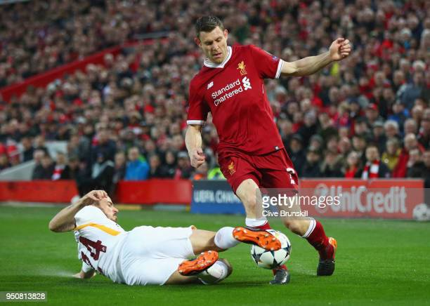 Alessandro Florenzi of AS Roma tackles James Milner of Liverpool during the UEFA Champions League Semi Final First Leg match between Liverpool and AS...
