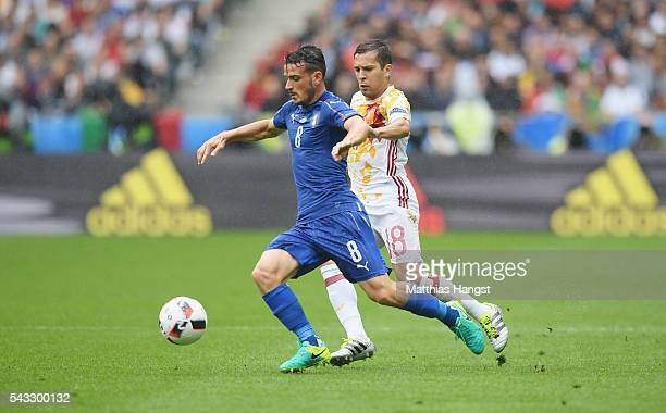 Alessandro Florenzi of Italy and Jordi Alba of Spain compete for the ball during the UEFA EURO 2016 round of 16 match between Italy and Spain at...