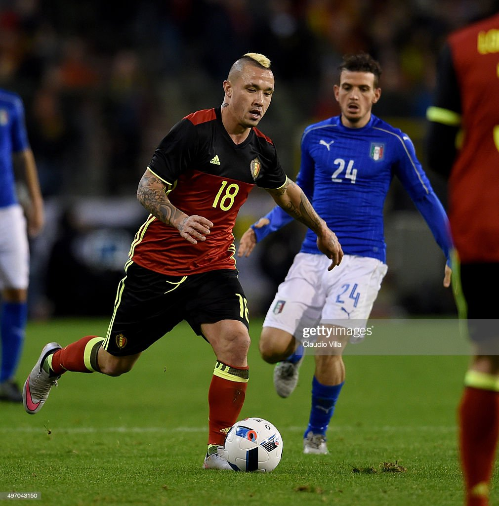Alessandro Florenzi of Italy and Radja Nainggolan of Belgium #18 compete for the ball during the intermational friendly match between Belgium and Italy at King Baudouin Stadium on November 13, 2015 in Brussels, Belgium.