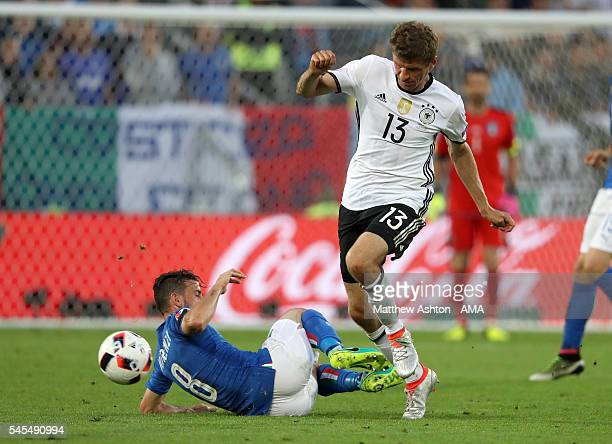 Alessandro Florenzi of Italy and Thomas Muller of Germany during the UEFA Euro 2016 quarter final match between Germany and Italy at Stade Matmut...