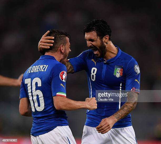 Alessandro Florenzi of Italy celebrates after scoring the first goal during the UEFA EURO 2016 Qualifier between Italy and Norway at Olimpico Stadium...