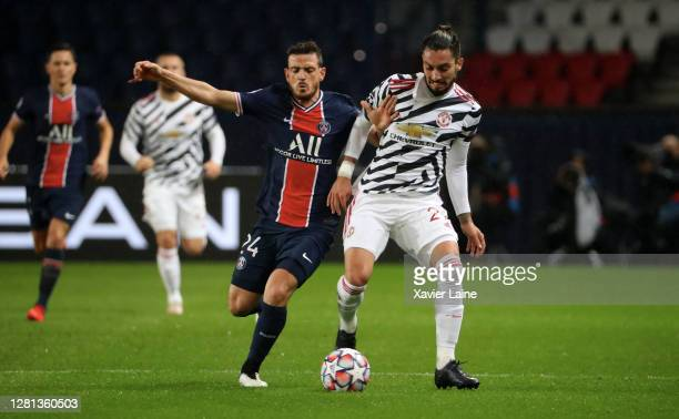 Alessandro Florenzi of Paris SaintGermain in action with Alex Telles of Manchester United during the UEFA Champions League Group H stage match...