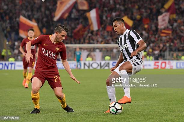 Alessandro Florenzi of Roma and Alex Sandro of Juventus in action during the serie A match between AS Roma and Juventus at Stadio Olimpico on May 13...
