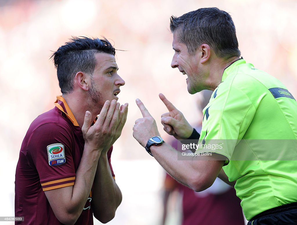 Alessandro Florenzi of Roma and referee Daniele Orsato argue during the Serie A match between AS Roma and ACF Fiorentina at Stadio Olimpico on December 8, 2013 in Rome, Italy.