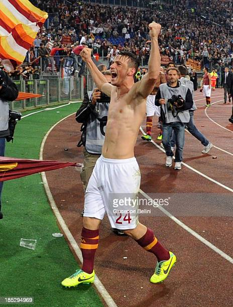 Alessandro Florenzi of Roma celebrates the victory after the Serie A match between AS Roma and SSC Napoli at Stadio Olimpico on October 18 2013 in...